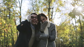 Man and woman laugh and show his hands into the distance. stock video