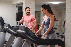 Man and woman laughing on treadmill stock images