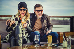 Man and woman laughing. Man and women laughing by the river Royalty Free Stock Photo