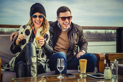 Man and woman laughing. Man and women laughing with river in background Stock Image