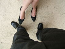 Man and woman legs. And shoes stock photos