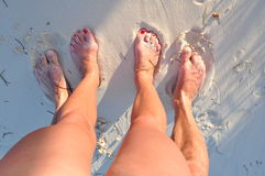 Man and woman legs. On beach Royalty Free Stock Images