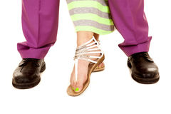Man woman legs close her step from behind Stock Image