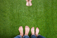 Man and woman legs standing close opposite child Royalty Free Stock Photo