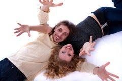 Man and woman lie on the floor Stock Photos