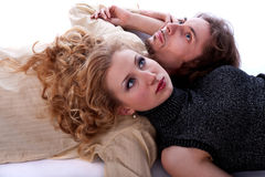 Man and woman lie on the floor Stock Images