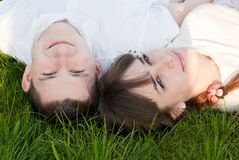 Man and woman lie on the grass Stock Photography