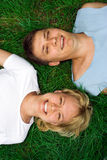 Man and woman lie on grass. Man and woman lie on green grass Royalty Free Stock Photos