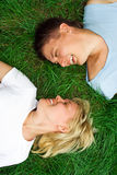 Man and woman lie on grass. Man and woman lie on green grass Royalty Free Stock Images