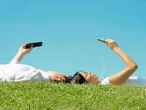Man and woman lie on the grass Royalty Free Stock Photography
