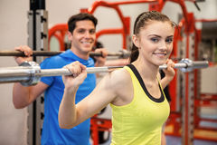 Man and woman lifting barbells together Royalty Free Stock Photo