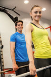 Man and woman lifting barbells together Royalty Free Stock Image