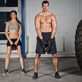 Man and woman lifting kettle bell crossfit Royalty Free Stock Photography