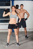 Man and woman lifting kettle bell crossfit Royalty Free Stock Image