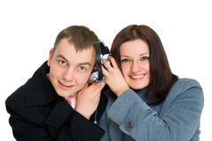 Man and woman listen headphones royalty free stock photo