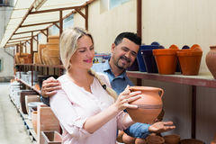 Man and woman in local atelier. Man and women spending time in workshop atelier Royalty Free Stock Image