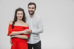 A man and a woman with long hair, supporting each other with love. Valentine`s Day. A woman dressed in a red dress of a. A men and a women with long hair stock images