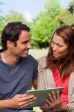 A man and a woman look into each others eyes while they are hold Royalty Free Stock Images