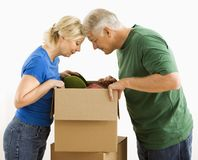 Man and woman looking in box. Royalty Free Stock Images