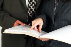 Man and woman looking at business documents Royalty Free Stock Photo