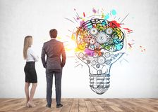 Man and woman looking at business idea sketch royalty free stock image