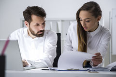 Man and woman looking at clipboard document Royalty Free Stock Image