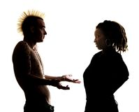 Man and woman looking at each other. Man with Mohawk and Woman wearing Dreadlocks Stock Images