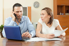 Man and woman looking financial document at home. Man and women looking financial document Stock Image