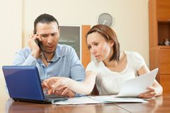 Man and woman looking financial document Stock Photography
