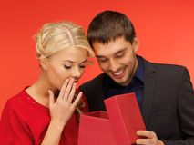Man and woman looking inside the gift box Stock Image