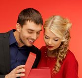 Man and woman looking inside the gift box Stock Images