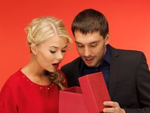 Man and woman looking inside the gift box Royalty Free Stock Images
