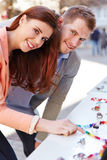 Man and woman looking at jewelry Royalty Free Stock Photography