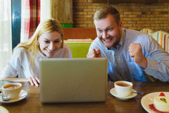 Man and woman Looking at the laptop. They are happy and successful Stock Image