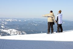 Man and woman looking out. From atop a mountain Stock Photography