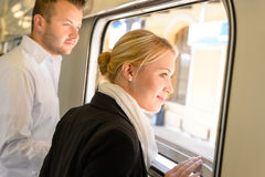 Man and woman looking out train window Royalty Free Stock Photography