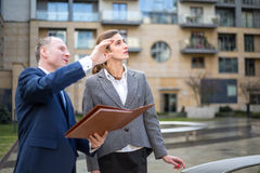 Man and woman looking and pointing up Royalty Free Stock Images