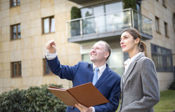 Man and woman looking and pointing up Royalty Free Stock Photo