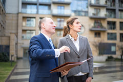Man and woman looking and pointing up Stock Photography