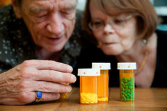 Man and woman looking at prescription medications Royalty Free Stock Photo