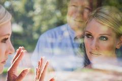 Man and woman looking at reflections Stock Photos
