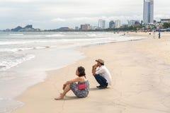 Man and woman looking into sea in China Beach Danang Royalty Free Stock Image
