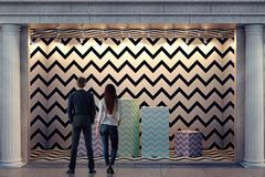 Man and woman looking at storefront Stock Images
