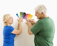 Man and woman looking at swatches. Royalty Free Stock Image