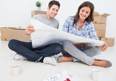 Man and woman looking at their house plans Stock Images