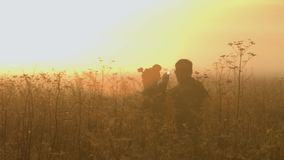 A man and a woman looking the way in the fog. Slow motion stock video footage