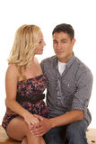 Man and woman she looks at him with a smile sitting Royalty Free Stock Photo