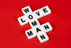 Man, woman and love. Words on red background Royalty Free Stock Photos