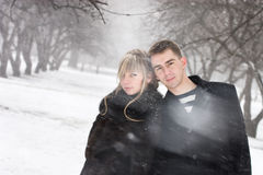 Man and woman in love in blizzard.  Stock Image