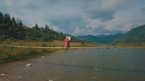 Man and woman in love on a bridge over the river. Aerial shot royalty free stock photos